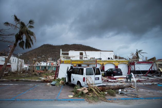 A picture shows a wrecked car in the streets of Marigot, on Sept. 9 in St. Martin island devastated by...