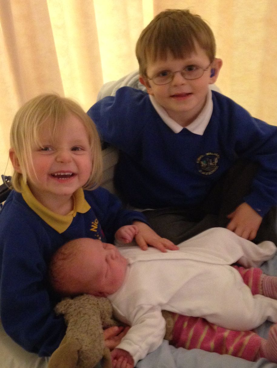 Pippa with her older brother Aubrey, five at the time, and her baby brother Elliott, who was born on...