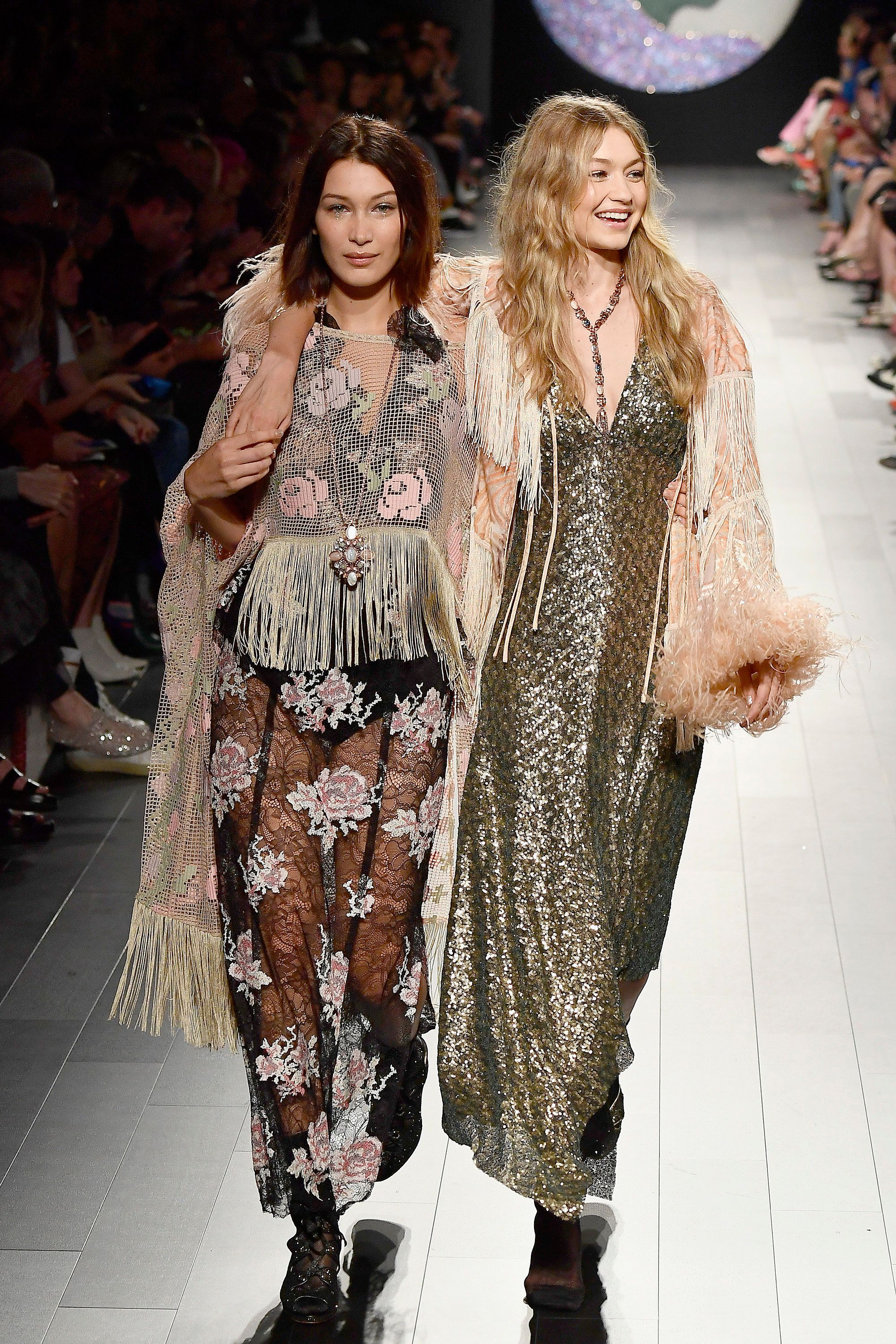 NEW YORK, NY - SEPTEMBER 11:  Models Bella Haddid and Gigi Hadid walk the runway for Anna Sui fashion show during New York Fashion Week: The Shows at Gallery 1, Skylight Clarkson Sq on September 11, 2017 in New York City.  (Photo by Frazer Harrison/Getty Images For NYFW: The Shows)