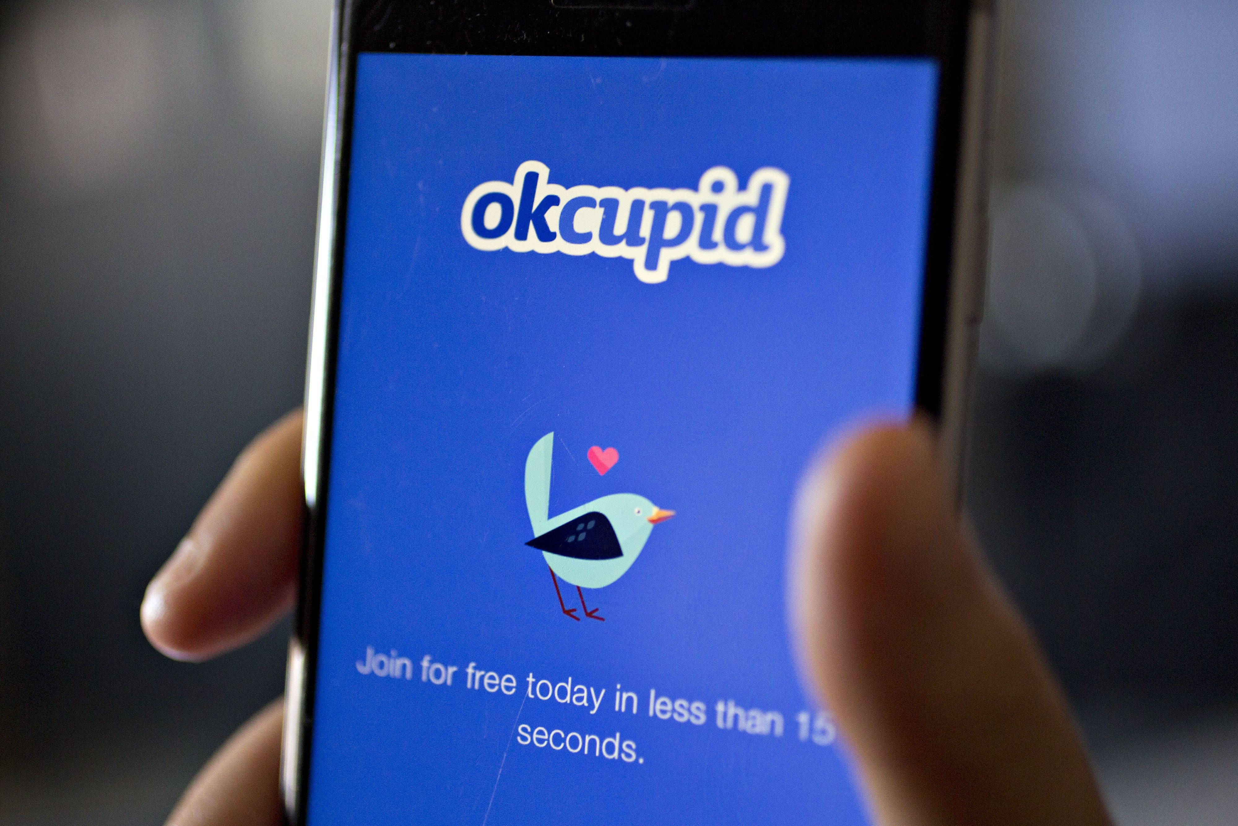 The OkCupid application is demonstrated for a photograph on an Apple Inc. iPhone in Washington, D.C., U.S., on Saturday, Feb. 4, 2017. IAC/InterActiveCorp, parent of Match Group Inc. which operates a number of dating services including OkCupid, beat analysts estimates for revenue and profit in the fourth quarter when figured were released on January 31. Photographer: Andrew Harrer/Bloomberg via Getty Images