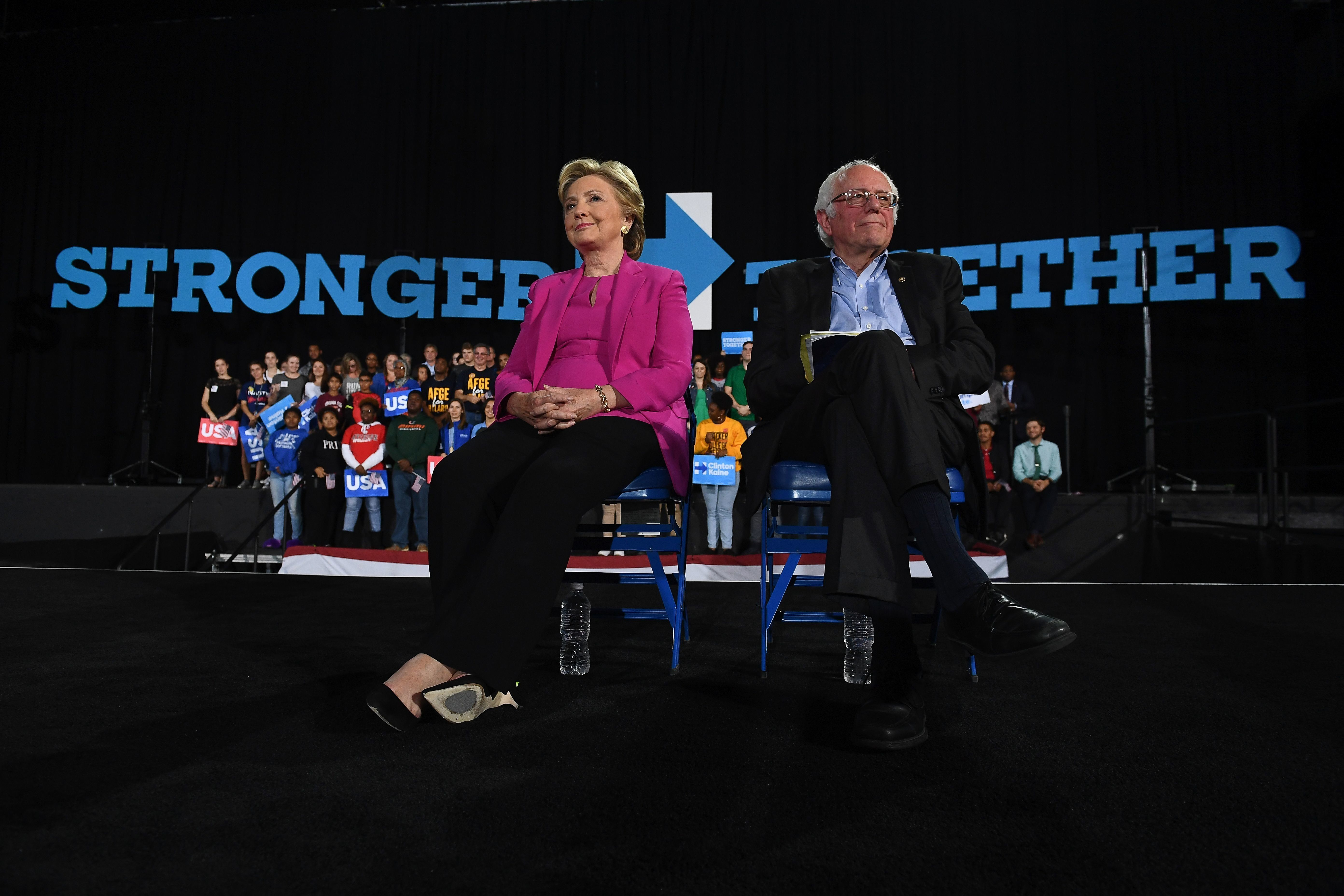 US Democratic presidential nominee Hillary Clinton and Bernie Sanders listen to singer Pharrell Williams during a campaign rally in Raleigh, North Carolina, on November 3, 2016.   / AFP / JEWEL SAMAD        (Photo credit should read JEWEL SAMAD/AFP/Getty Images)