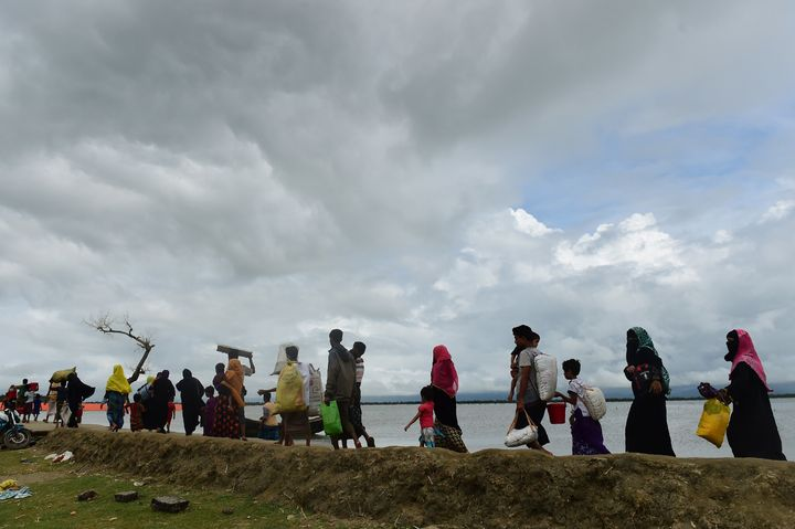 Rohingya Muslim refugees arrive from Myanmar after crossing the Naf river in the Bangladeshi town of Teknaf on September 12,