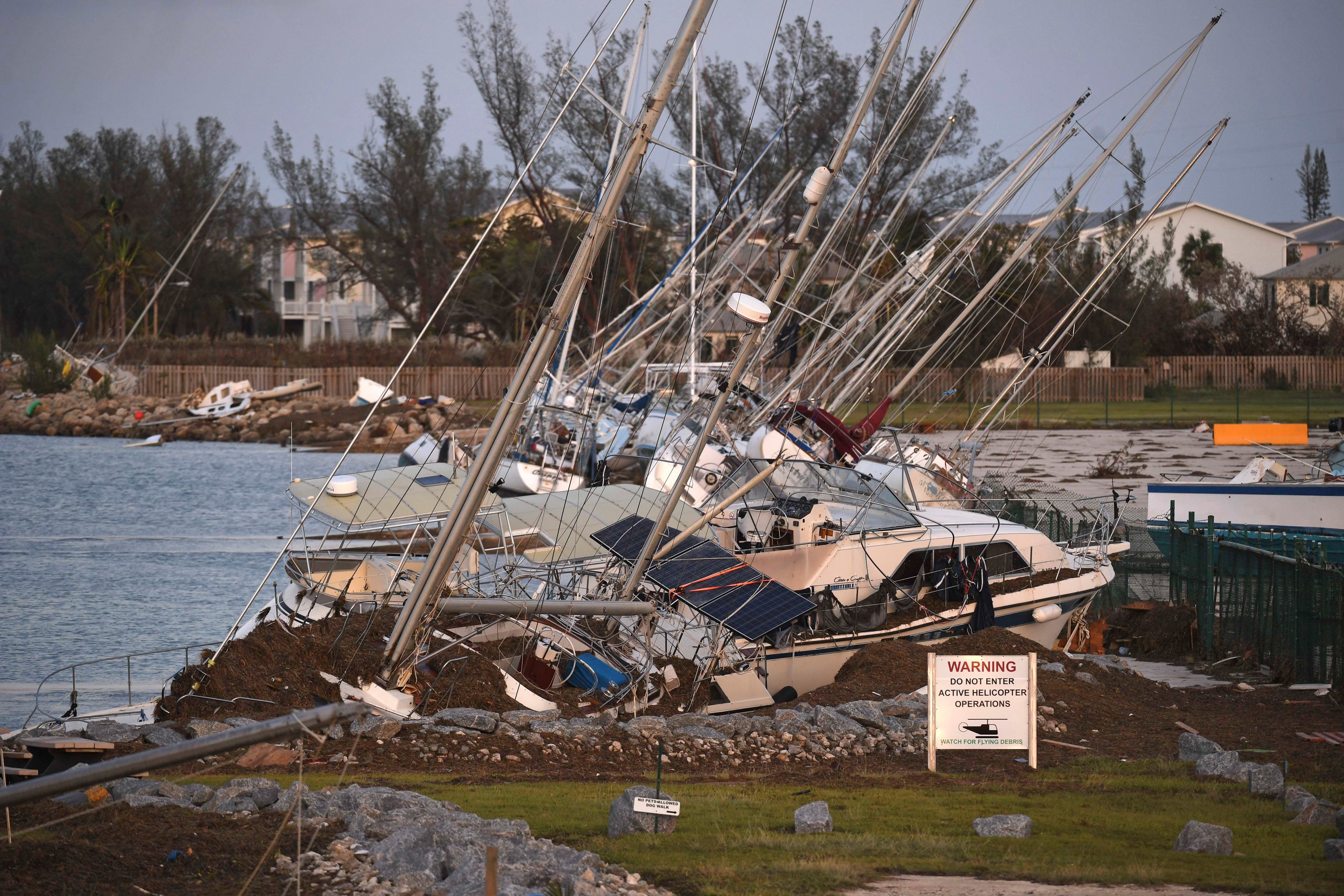 Pool via Getty Images Damaged sail boats are shown in the aftermath of Hurricane Irma on Monday in Key West Florida