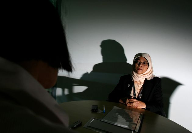 Halimah Yacob speaks to the press during an interview with Reuters in Singapore September 22, 2008, while...