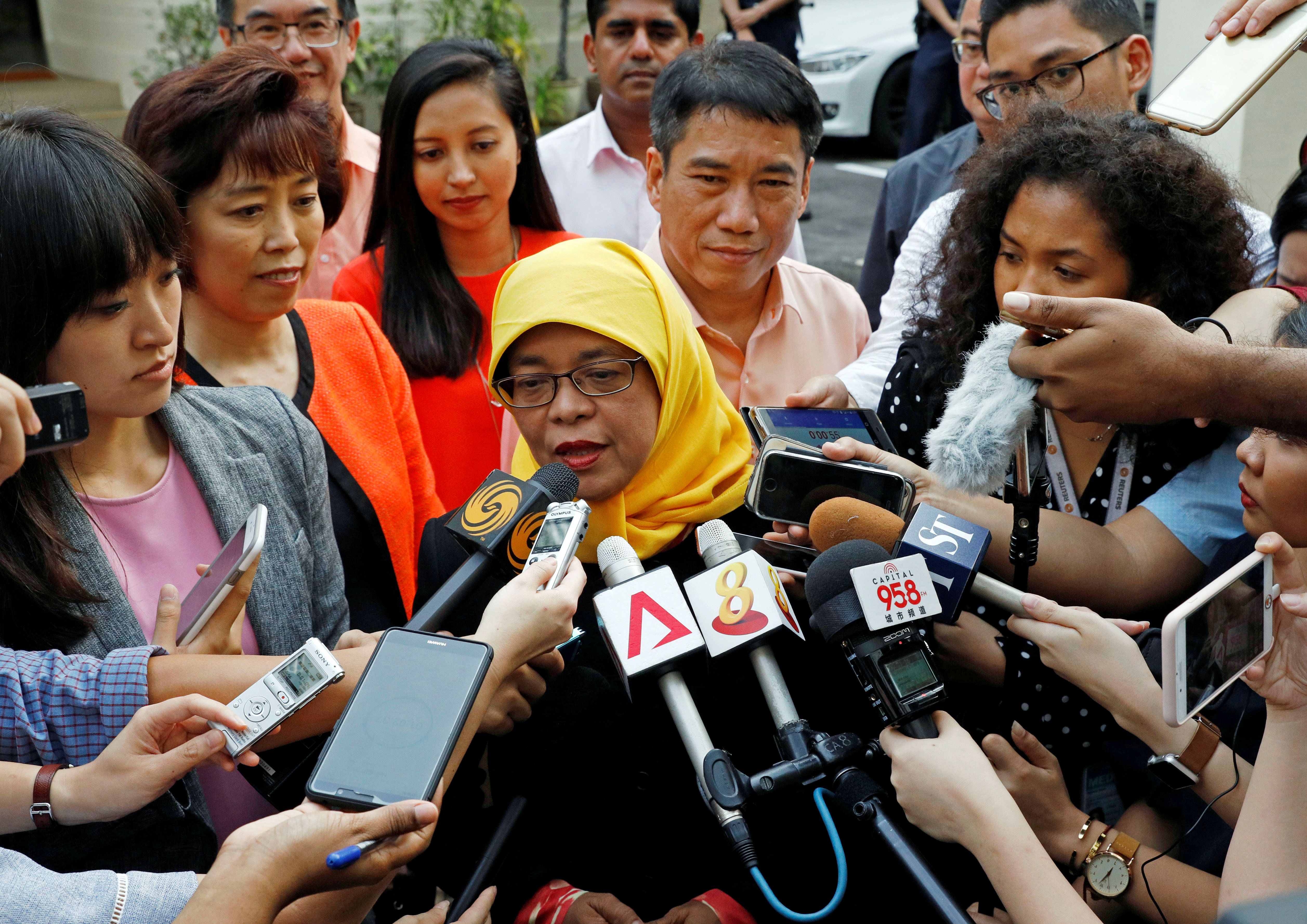 Former speaker of Singapore's parliament, Halimah Yacob, speaks to the media at the Elections Department after she was given the certificate of eligibility to contest the election by the Presidential Elections Committee in Singapore September 11, 2017. REUTERS/Edgar Su