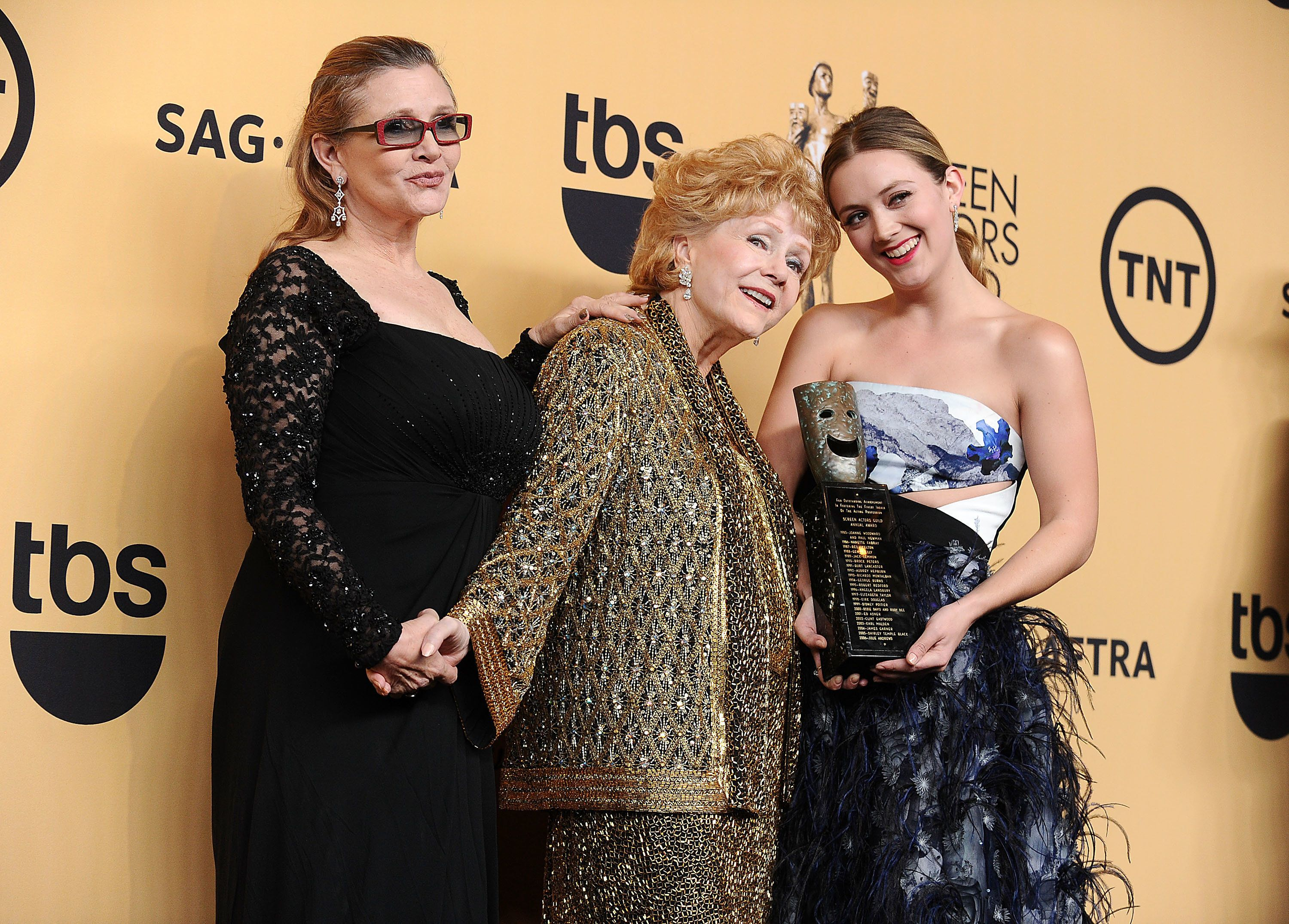 LOS ANGELES, CA - JANUARY 25:  (L-R) Actress Debbie Reynolds, actress Carrie Fisher and Billie Lourd pose in the press room at the 21st annual Screen Actors Guild Awards at The Shrine Auditorium on January 25, 2015 in Los Angeles, California.  (Photo by Jason LaVeris/FilmMagic)