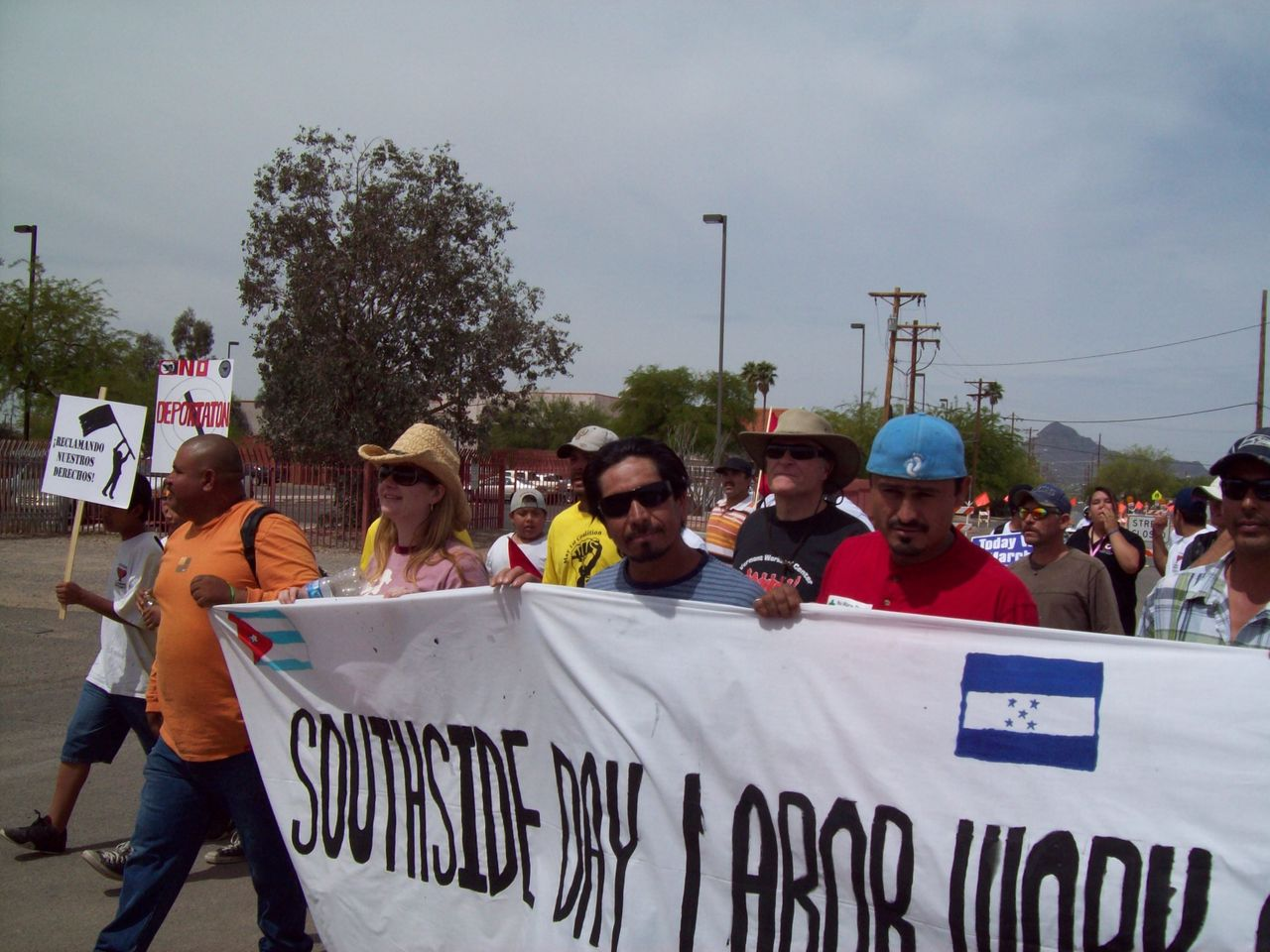 Rev. Alison Harrington (left, in pink) demonstrating with members with members of the Southside Worker Center against Arizona's anti-immigrant bill SB1070 in 2010.