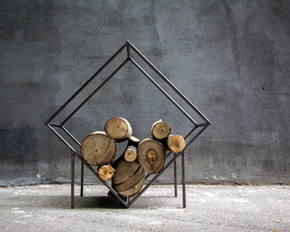 """Look for stylish ways to display firewood to instantly create a rustic, log-cabin feel, with or without the fireplace,"