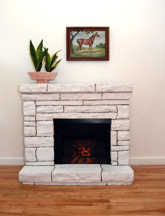 No fireplace? No problem. This faux stone electric fireplace will cozy up any room just the same, chimney accessories no