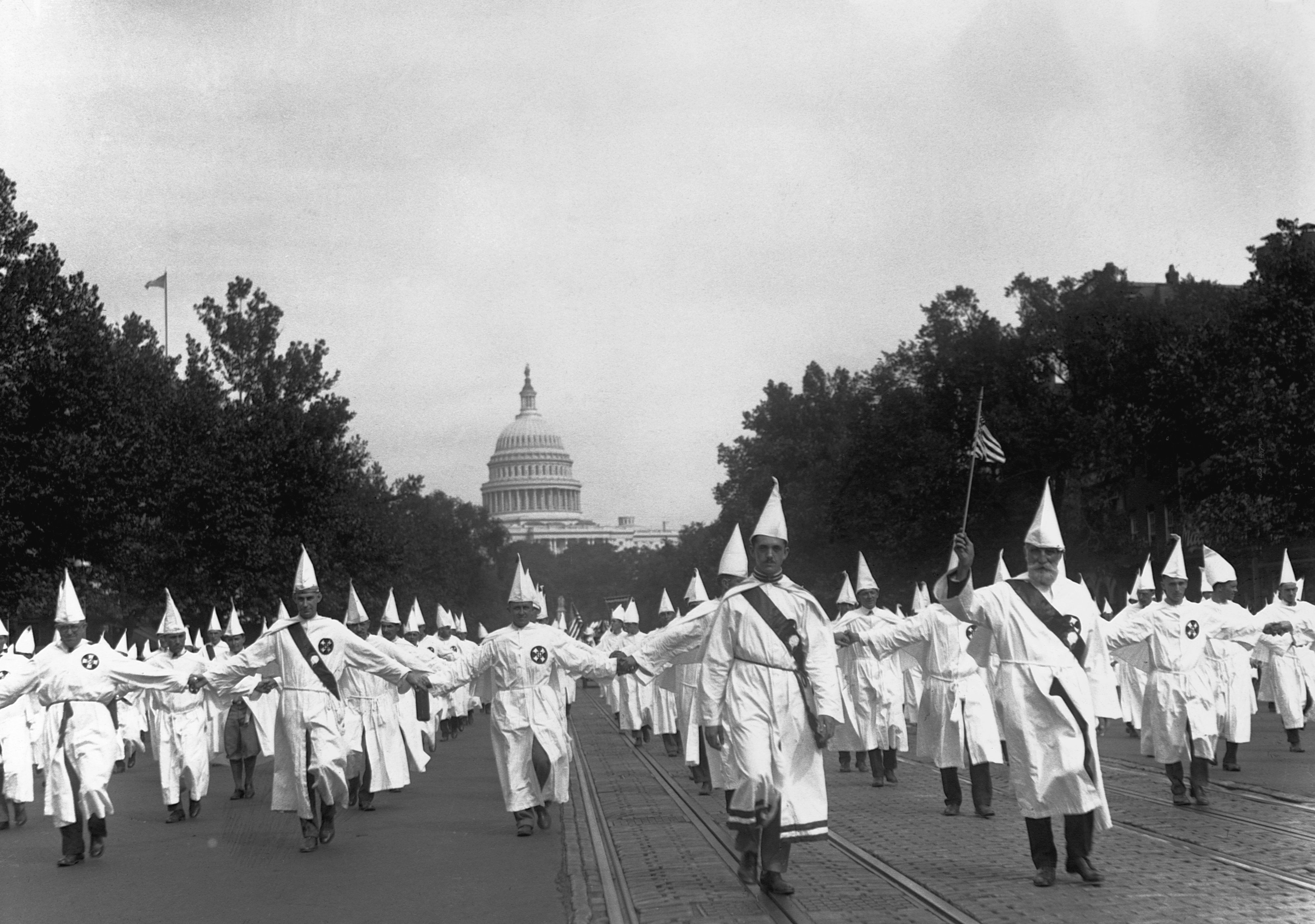 Ku Klux Klan members hold a march in Washington, DC, on August 9, 1925.