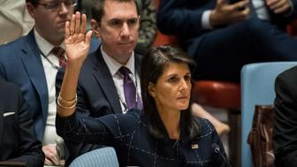 NEW YORK, NY - SEPTEMBER 11: Nikki Haley, United States ambassador to the United Nations, raises her hand as she votes yes to levy new sanctions on North Korea designed to curb their nuclear ambitions during a meeting of the United Nations Security Council concerning North Korea at UN headquarters, September 11, 2017 in New York City. The Security Council unanimously approved the new sanctions on North Korea. The United States softened its demands for tougher measures, including removing its demand for a full oil embargo, in a bid to win support from Russia and China. (Photo by Drew Angerer/Getty Images)
