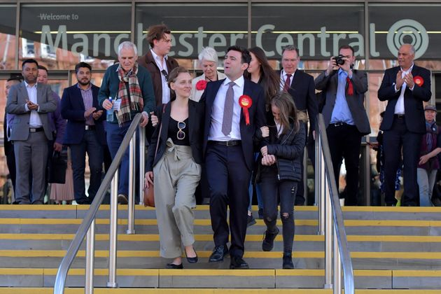 Labour's Andy Burnham (C) celebrates winning the Greater Manchester mayoral election with wife Marie-France...