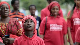 A Bring Back Our Girls (BBOG) campaigner looks on during a protest procession marking the 500th day since the abduction of girls in Chibok, along a road in Abuja August 27, 2015. The Islamist militant group Boko Haram kidnapped some 270 girls and women from a school in Chibok a year ago. More than 50 eventually escaped, but at least 200 remain in captivity, along with scores of other girls kidnapped before the Chibok girls. REUTERS/Afolabi Sotunde