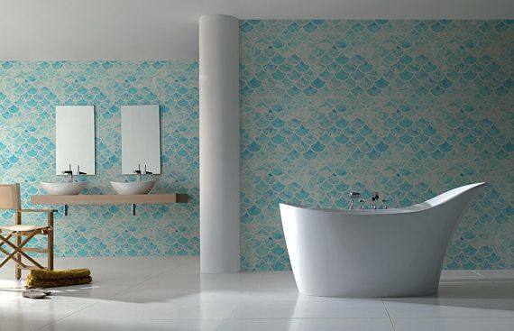 To mimic the soft, earthy tones of nature, try incorporating decor in natural tones, like light blue wallpaper. The bathroom