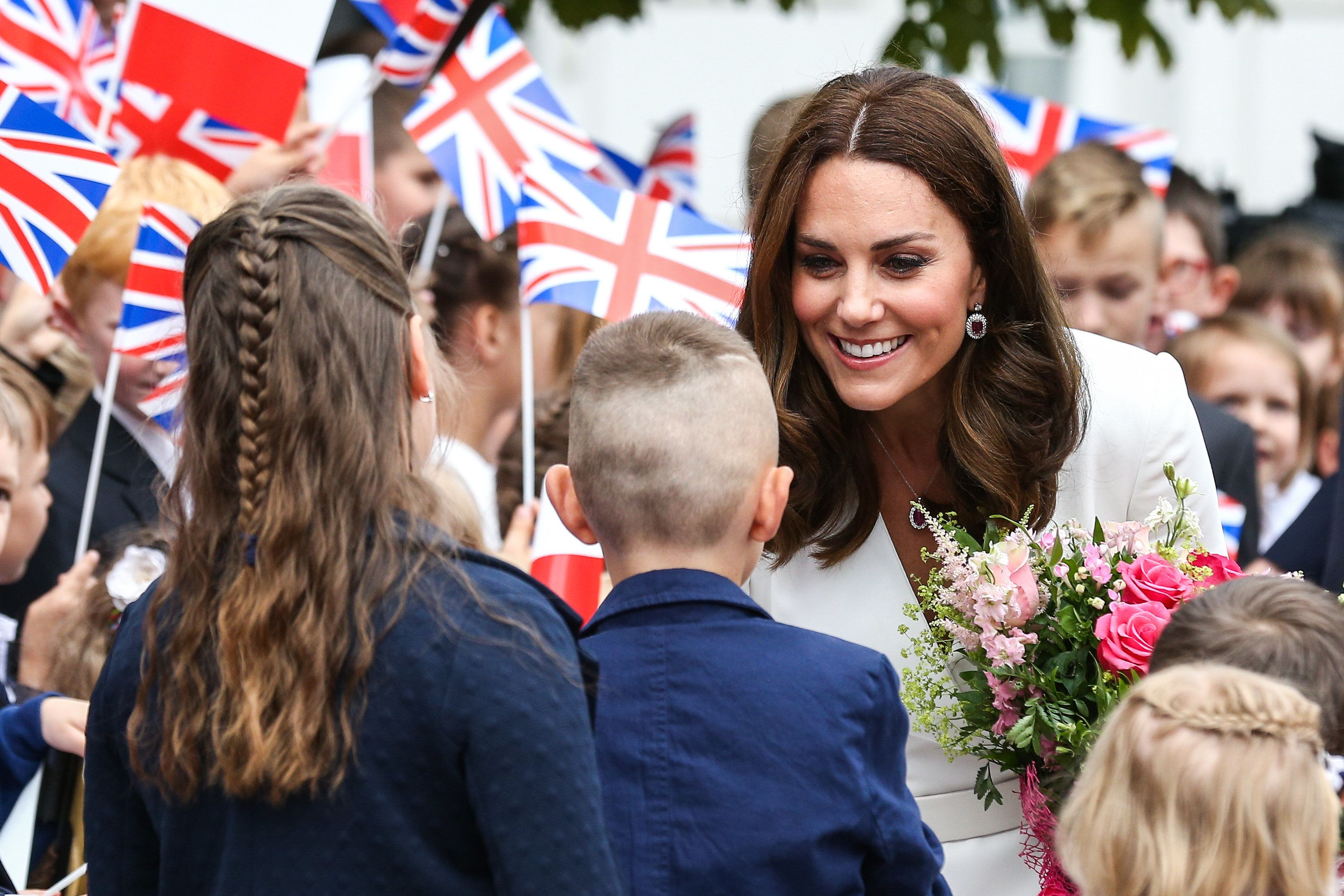 WARSAW, POLAND  JULY 17: (SOUTH AFRICA AND POLAND OUT) Their Royal Highnesses Prince William and Kate Middleton proceed to the Adam Mickiewicz Monument on July 17, 2017 in Warsaw, Poland. Prince William and Kate Middleton are visiting Warsaw with their two children, Princess Charlotte and Prince George. (Photo by Karol Serewis /Gallo Images Poland/Getty Images)