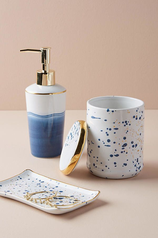 Displaying some of your most beautiful bathroom accessories like a fresh set of flowers, a marble tray, or pretty toiletries,