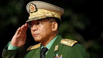 Myanmar Commander in Chief Senior General Min Aung Hlaing salutes as he attends an event marking the anniversary of Martyrs' Day at the Martyrs' Mausoleum in Yangon July 19, 2016. REUTERS/Soe Zeya Tun