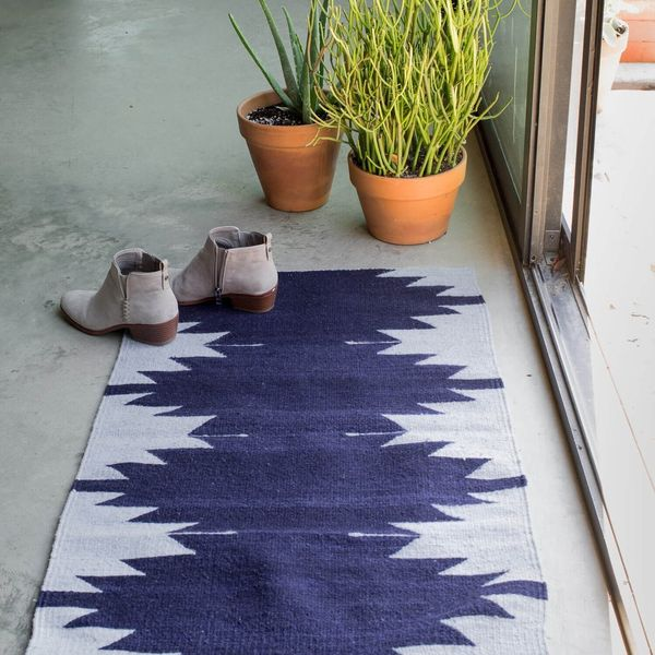 "<a href=""https://www.the-citizenry.com/collections/rugs/products/sierra-rug-indigo"" target=""_blank"">Shop it here</a>."