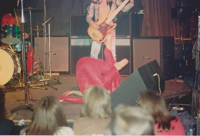 <em>Janita Haan upside down mid-performance</em>