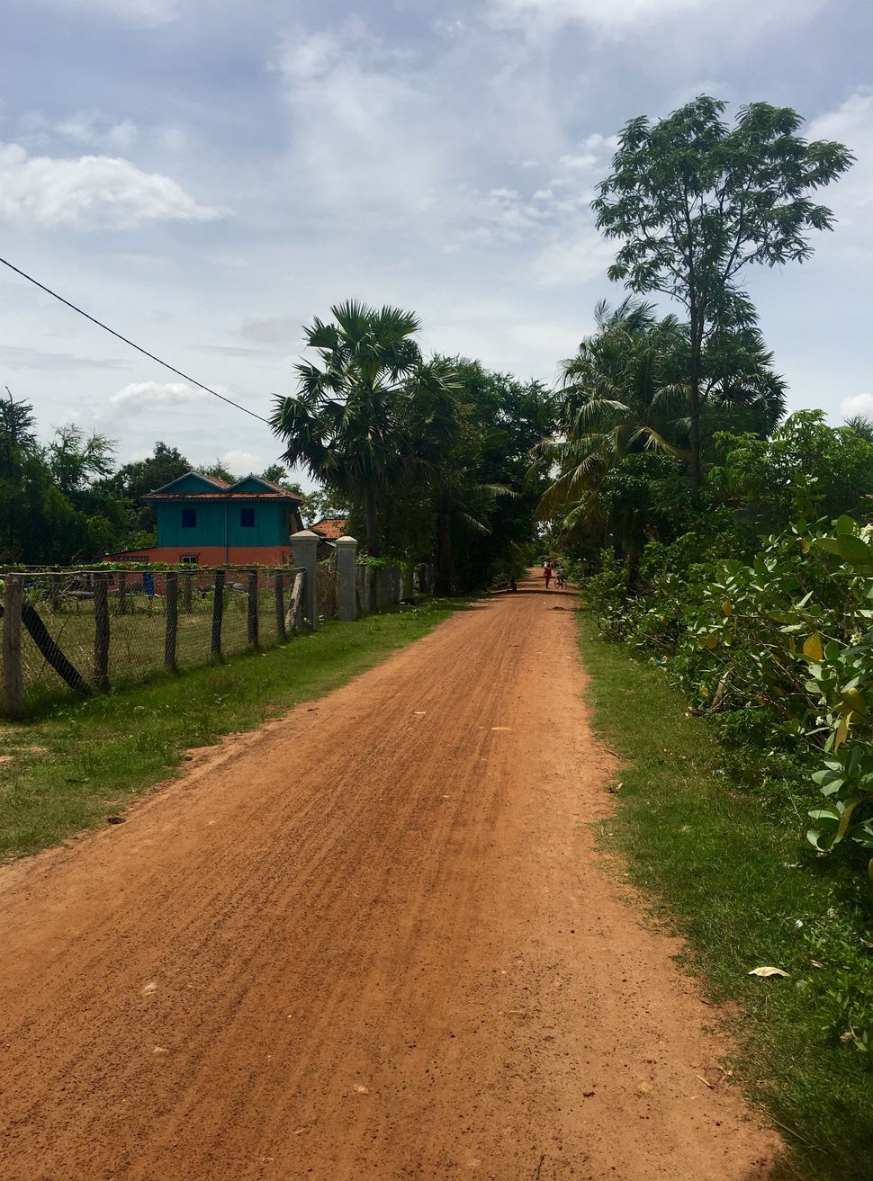 The dirt road in a Kampong Speu village on which many of the recruited brides drive to get to China.