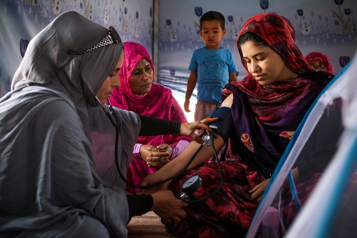 Tindouf, Algeria - A Sahrawi midwife measures the blood  pressure of a woman after giving birth in a post-partum visit.