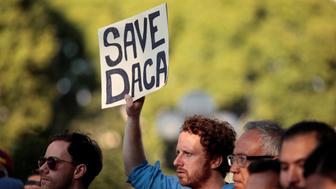 Supporters of the Deferred Action for Childhood Arrivals (DACA) program rally on Olivera Street in Los Angeles, California, September 5, 2017. REUTERS/ Kyle Grillot