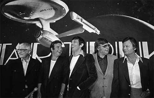"""Robert Wise (far left) keeps his distance from Gene Roddenberry (second from right) at a """"Star Trek: The Motion Picture"""" pres"""