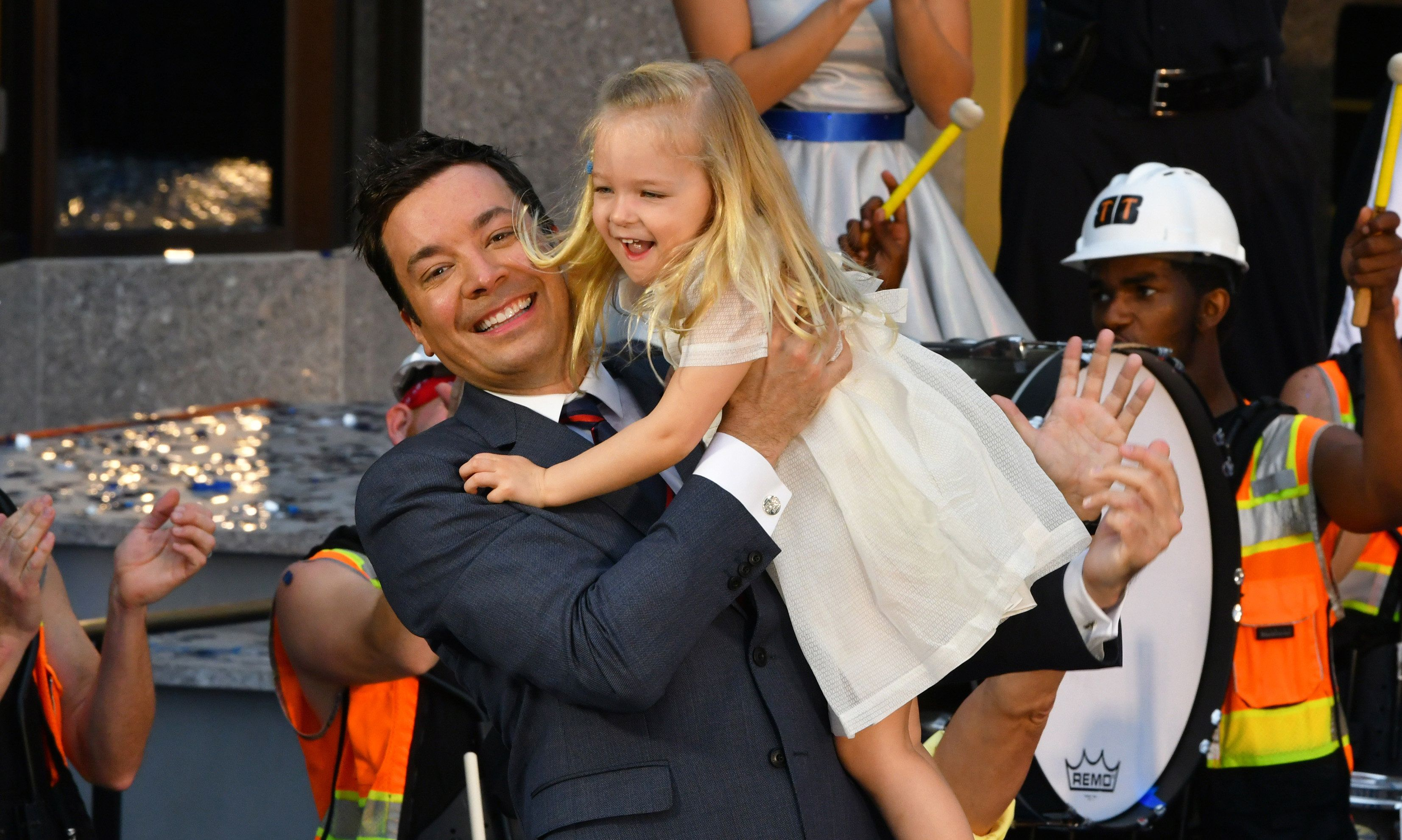 Orlando, FL - April 06: Jimmy Fallon holds his three year old daughter Winnie during the grand opening for the Race Through New York Starring Jimmy Fallon at Universal Orlando Resort on April 06, 2017 in Orlando, Florida.  The event included a parade with Fallon himself riding on a float in a parade to cut the ribbon for the new attraction.   PHOTOGRAPH BY Tim Shortt / ddp USA / Barcroft Images  London-T:+44 207 033 1031 E:hello@barcroftmedia.com - New York-T:+1 212 796 2458 E:hello@barcroftusa.com - New Delhi-T:+91 11 4053 2429 E:hello@barcroftindia.com www.barcroftimages.com (Photo credit should read Tim Shortt / Barcroft Media via Getty Images)