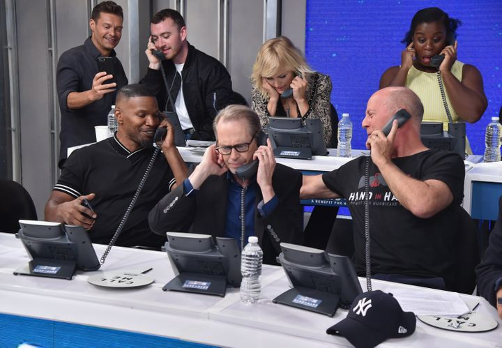 Sam Smith, Jamie Foxx, Steve Buscemi and Bruce Willis and others took in phone donations for hurricane survivors on Tuesday.