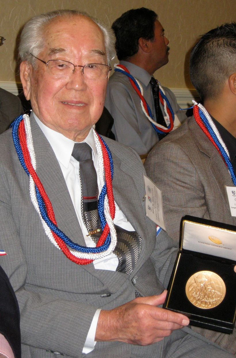 Ray Mayeda in 2011 holding the Congressional Gold Medal awarded to his brother Al for serving in U.S. Army during WWII