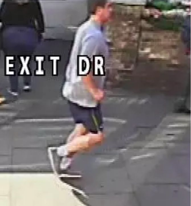 Police have released a new image of the jogger suspected of pushing a woman in front of a double-decker...