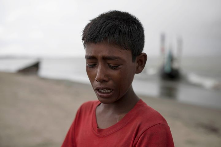 A young Rohinga boy cries after the wooden boat he was traveling on from Myanmar crashed into the shore, Sept. 12, 2017, in D