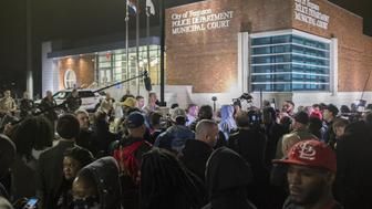WASHINGTON, USA - MARCH 12: Protestors gather and shout slogans in front of the Ferguson Police Department during ongoing protests after the Justice Department released their report exposing corruption in the police department and court system of Ferguson, USA on March 12, 2015. Officials, including the Chief of Police, have been forced to resign after the release of the report. (Photo by Samuel Corum/Anadolu Agency/Getty Images)