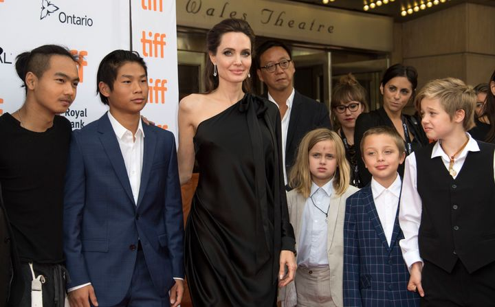 Jolie poses with some of her children at the Toronto International Film Festival.