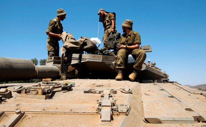 A picture taken on September 13, 2017 shows Israeli soldiers standing on the top of a Merkava tank during the last day of a m