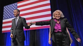 US President Barack Obama holds hands with Edie Windsor after she introduced him during the Democratic National Committee LGBT Gala at Gotham Hall on June 17, 2014 in New York, New York. AFP PHOTO/Mandel NGAN        (Photo credit should read MANDEL NGAN/AFP/Getty Images)