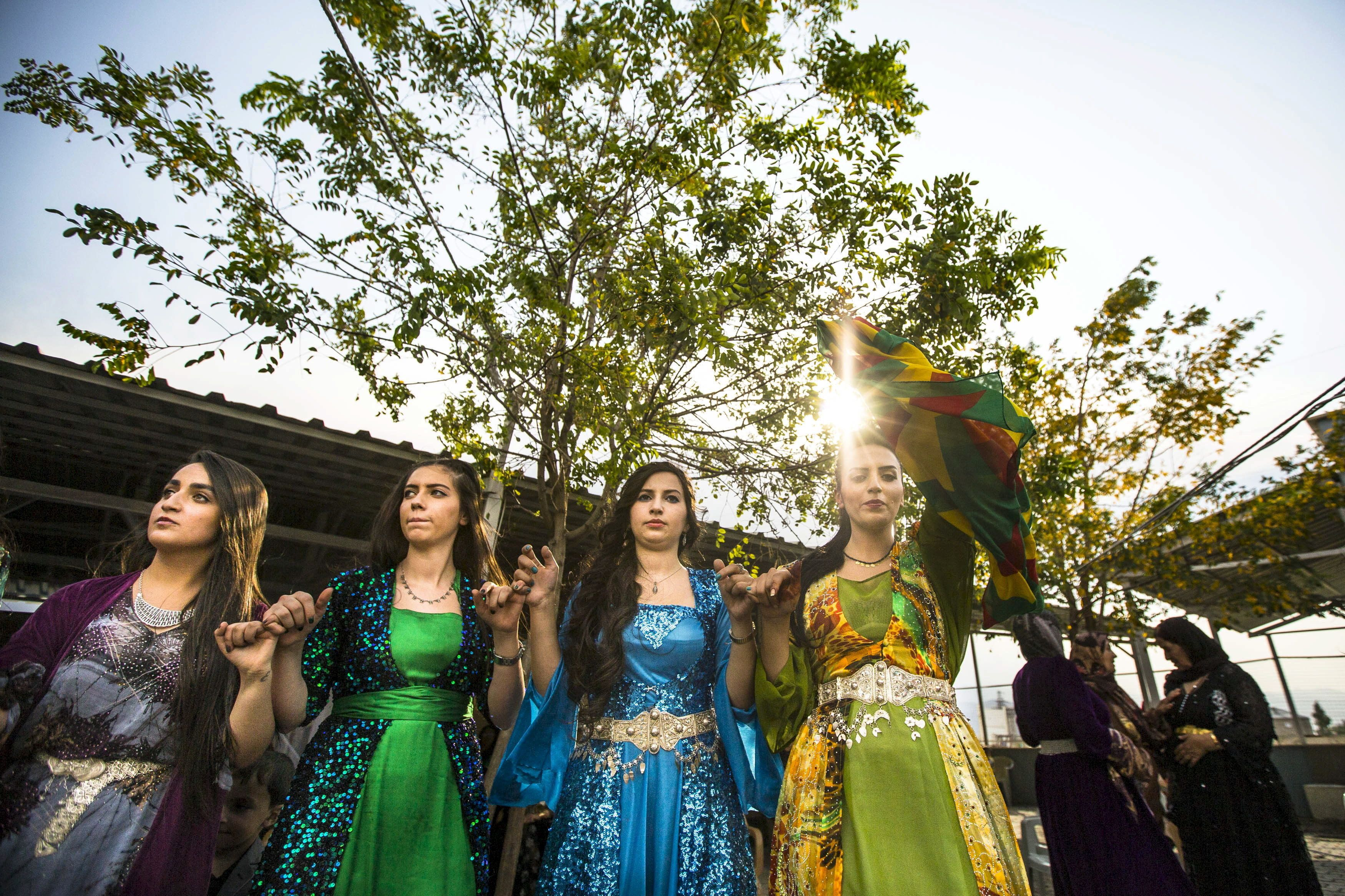 Turkish Kurdish women in traditional dresses dance during a wedding ceremony for newly married couple Sefket and Dilges Baskin, in Yuksekova in the Kurdish-dominated southeastern Hakkari province of Turkey, September 6, 2015. Militants of the outlawed Kurdistan Workers' Party (PKK) have been clashing almost daily with security forces in southeast Turkey since July, when a two-year ceasefire between the PKK and the government collapsed, with both sides blaming each other. Officials say that more than 70 members of the security forces and hundreds of Kurdish militants have been killed. REUTERS/Huseyin Aldemir