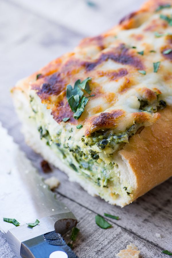 "<strong>Get the <a href=""https://theviewfromgreatisland.com/cheesy-spinach-artichoke-bread-recipe/"" target=""_blank"">Cheesy Sp"