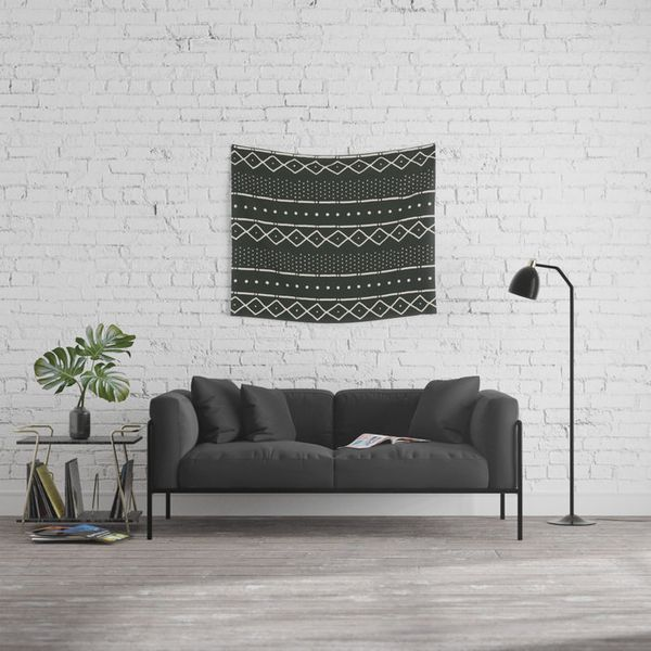 "<a href=""https://society6.com/product/mudcloth-in-bone-on-black_tapestry"" target=""_blank"">Shop it here</a>."