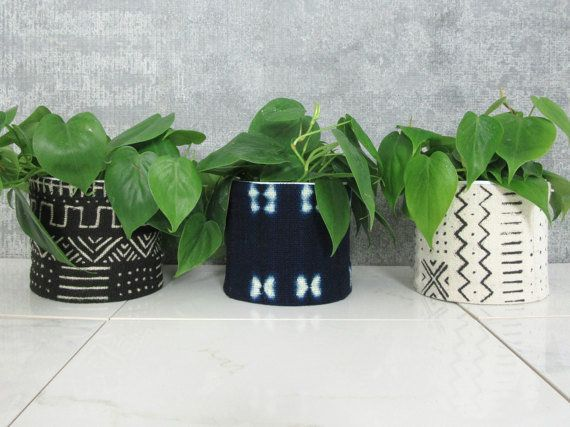 "<a href=""https://www.etsy.com/listing/472976875/mudcloth-planters-african-mud-cloth"" target=""_blank"">Shop them here</a>.&nbsp"