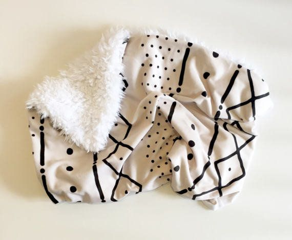 "<a href=""https://www.etsy.com/listing/505980040/mud-cloth-baby-blanket-faux-fur-minky"" target=""_blank"">Shop it here</a>.&nbsp"