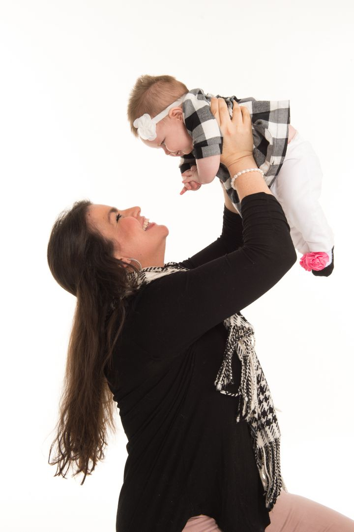 <p>Pictured are St. Jude cancer survivor  Tayde Cruz Dodds and her 10-month-old daughter. She works on the Patient Outreach team for ALSAC, the fundraising and awareness organization for St. Jude Children's Research Hospital.</p>