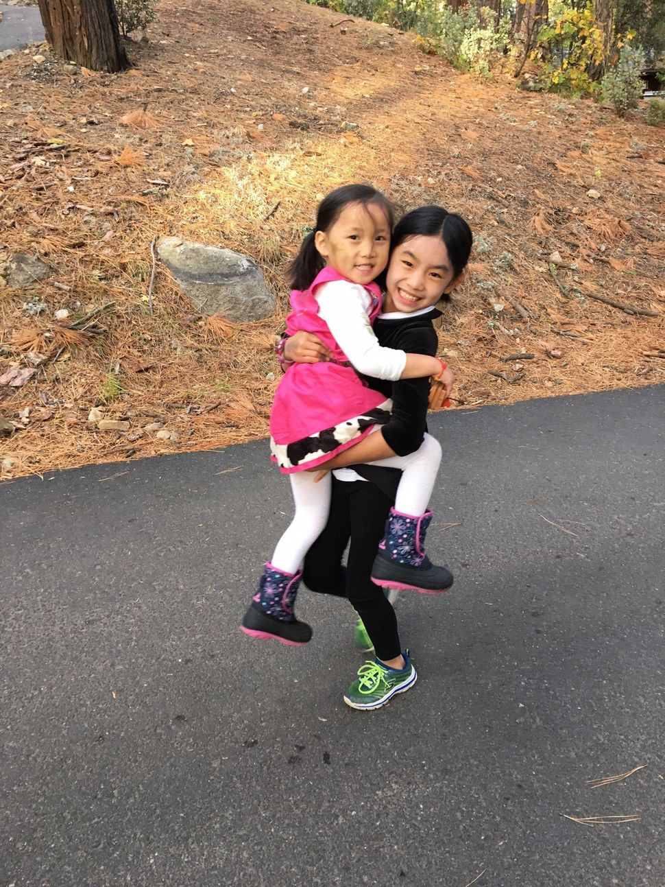 It took Kriss about four years to adopt her oldest daughter (right), but only about nine months to adopt her youngest (left).