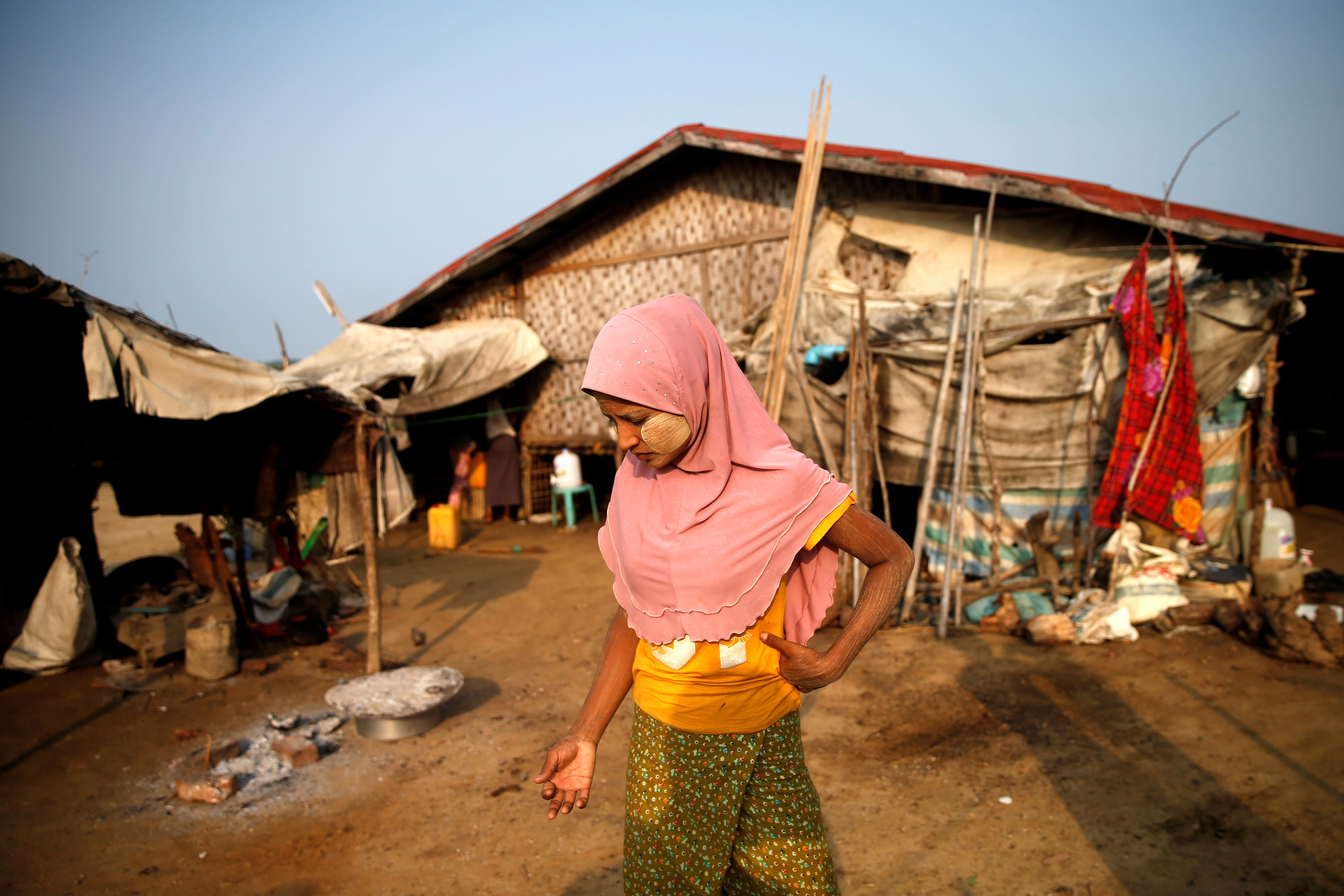 A Rohingya woman walks in a  refugee camp outside Kyaukpyu in Rakhine state, Myanmar May 18, 2017. Picture Taken May 18, 2017. REUTERS/Soe Zeya Tun