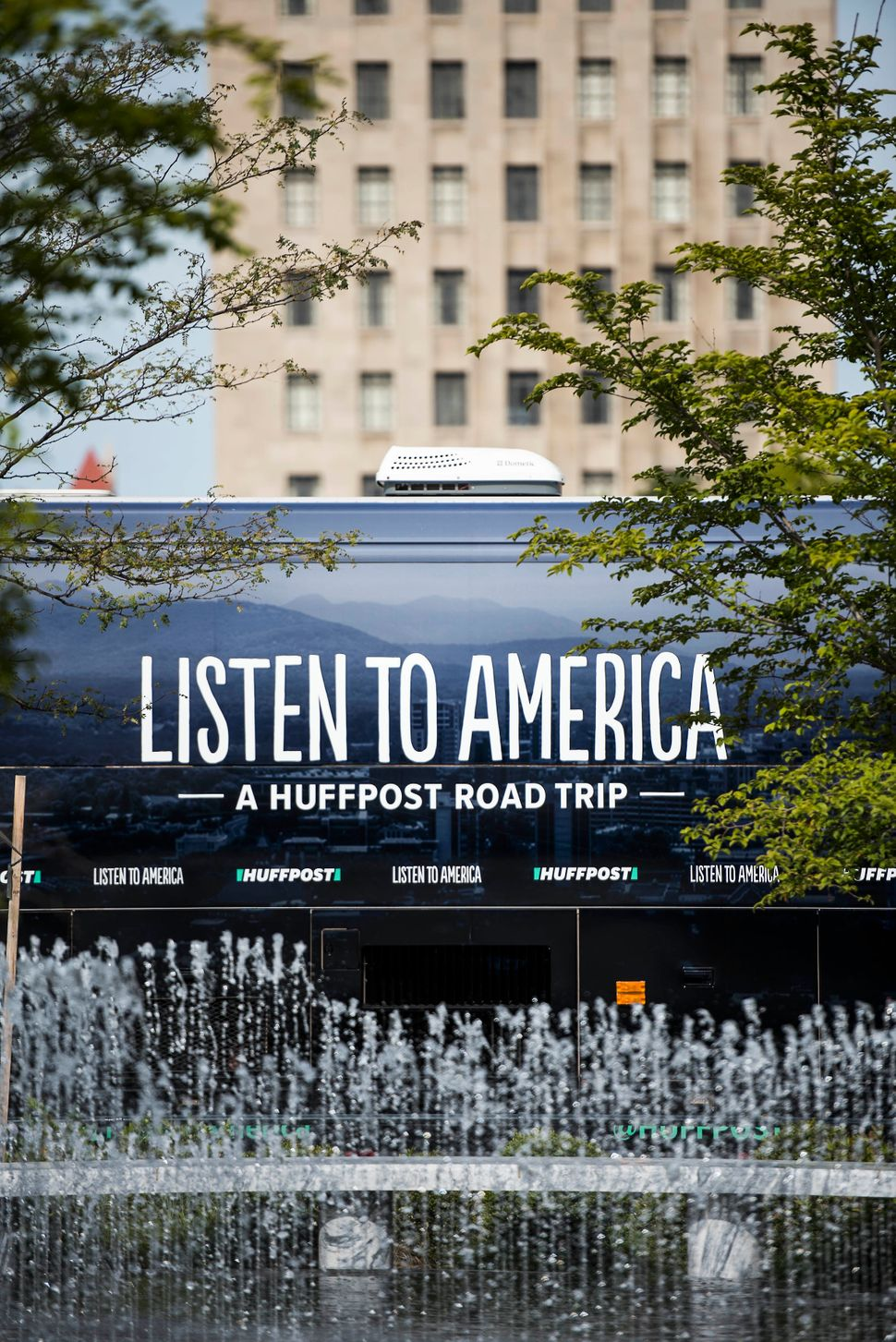 The HuffPost tour bus stops at Kiener Plaza Park near the Gateway Arch.