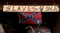 Man Posts 'Slaves 4 Sale' Sign Next To Confederate Flag To Prove He's No