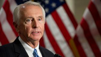 UNITED STATES - Dec 5: Gov. Steve Beshear, D-Ky. talks with reporters during a media availability on the Affordable Care Act immediately after a closed joint whip and caucus meeting in the U.S. Capitol on December 5, 2013. (Photo By Douglas Graham/CQ Roll Call)