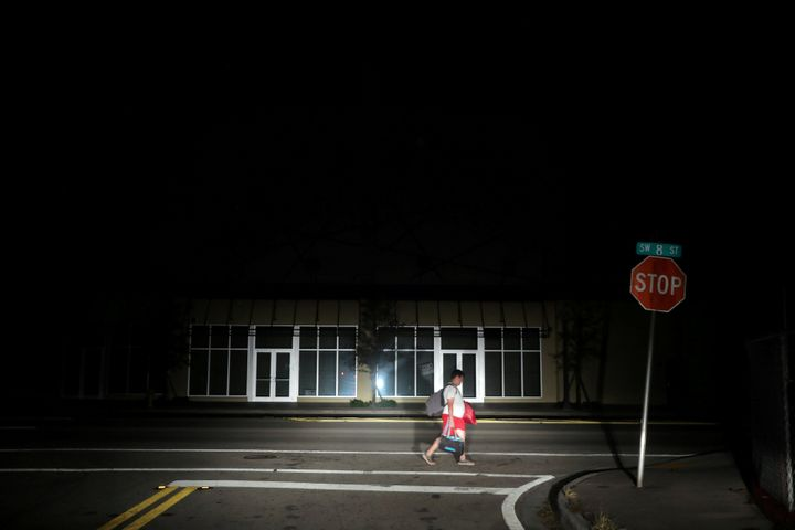 A man walks back home in the darkness as many areas of Miami still without electricity after Hurricane Irma strikes Florida,