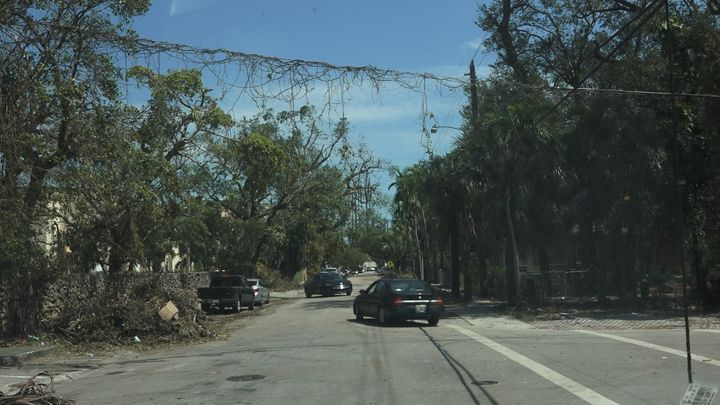 Debris drapes across a power line in Miami's Little Havana neighborhood. One of the city's poorest areas, Little Havana