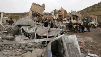 People gather on rubble of a house destroyed by a Saudi-led air strike in Sanaa, Yemen August 25, 2017. REUTERS/Khaled Abdullah